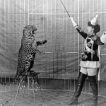 300px-Female_animal_trainer_and_leopard,_c1906